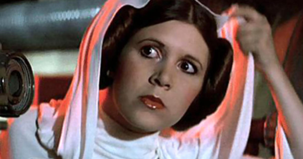 close up of princess leia taking off her hood