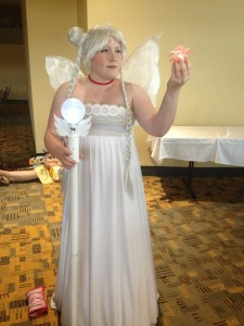 Neo Queen Serenity stands holding her staff and silver crystal