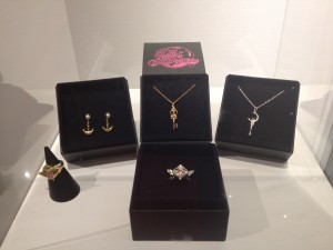 a display of the new sailor moon jewelry, two rings, one set of earrings and two necklaces