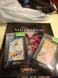 the myu brochure with two iphone 5 cases, one with a manga image of Usagi and the other with a manga image of Eternal Sailor Moon