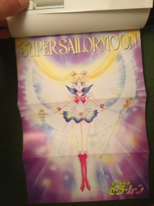 A pull out poster of Super Sailor Moon holding the holy grail and scepter