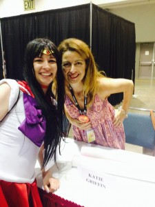 A sailor mars cosplayer stands next to Katie Griffin, voice actress of sailor mars