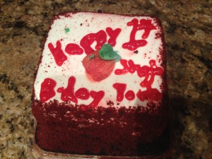 """a small red velvet cake with the words """"Happy 1st Birthday Shojo Power!"""""""