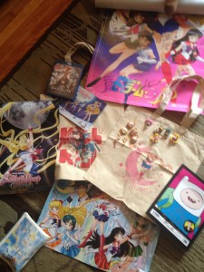 A bunch of Sailor Moon posters and merchandise