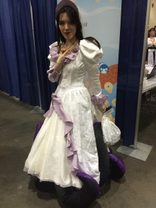 Human Ursula in a wedding dress with tentacles peeping out underneath the dress