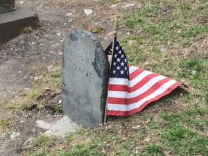 Paul Revere's tombstone with a tiny American flag next to it.