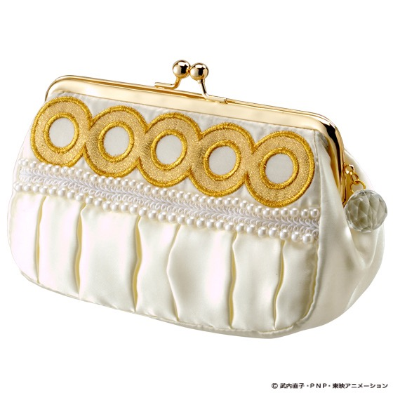 a white make up bag with princess serenity pearls and gold circles