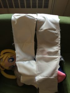 two strips of ivory fabric