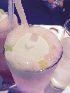 Vanilla ice cream floats in a pink fizzy drink