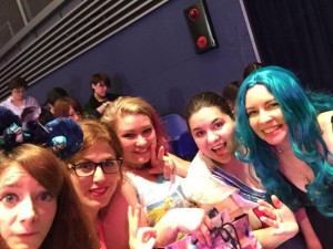 five young women pose in the AiiA theater