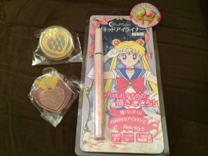 Two paper clips of Chibi Moon's brooches and the brown sailor moon eyeliner