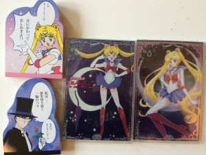 A sailor moon notepad, a tuxedo mask notepad and two packages of sailor moon postcards