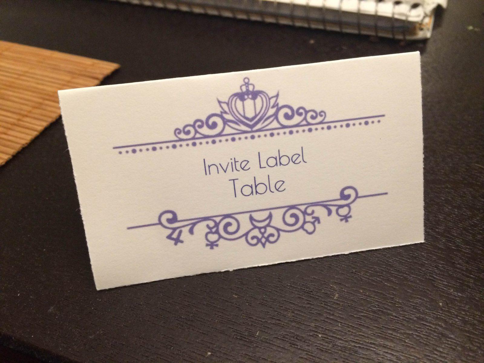 a name card with a purple Anna Sui design