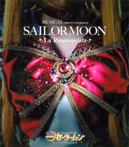 Close up of Sailor Moon's chest bow and brooch with sparkles. It's the cover image of the myu guide book.