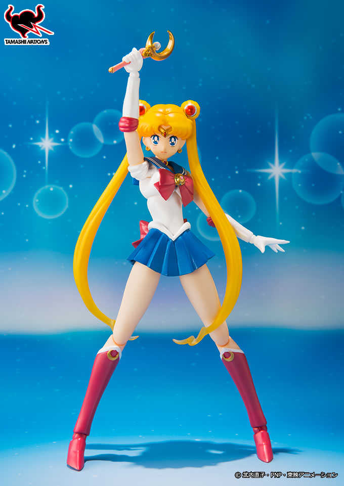 "Sailor Moon Figuarts stands, holding the crescent moon wand above her head, ready to yell ""Moon Healing Activation!"""