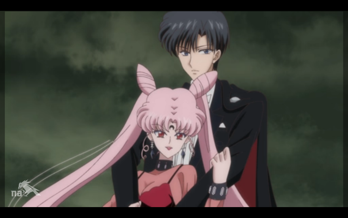 A brainwashed Tuxedo Mask holds Black Lady in his arms