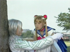 Zoisite leans against a tree while Sailor Moon leans over him