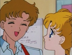 Andrew smiles while Usagi looks concerned