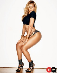 Beyonce has blonde hair and wears a short top and panties. She's sticking out her butt.