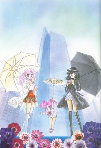 Chibiusa and Hotaru hold umbrellas in front of a building while wearing boots and raincoats. Chibichibi floats down with her own umbrella.