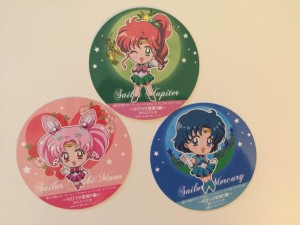 Three paper coasters from the Sailor Moon Cafe--Sailor Chibi Moon, Sailor Jupiter and Sailor Mercury