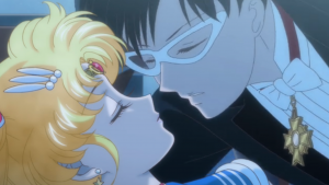 Tuxedo Mask leans over to kiss a sleeping Sailor Moon