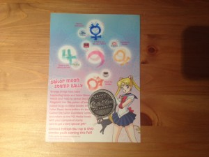 There's a card with planetary stamps and the VIZ Anime Expo Limited Edition Coin