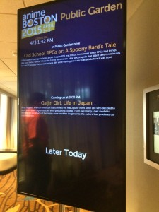 A sign outside the panel room with information about the panel Gaijin Girl