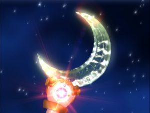screenshot from the tv show of the Moon Stick with a crystal crescent moon