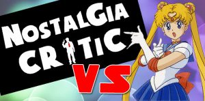 "The Words ""Nostalgia Critic vs"" and an image of Sailor Moon in her ""punish you"" pose"