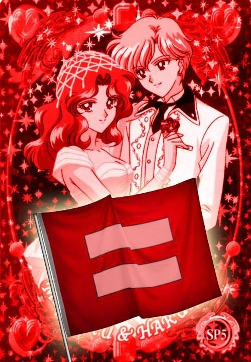 Michiru in a wedding dress, Haruka in a tux in front of a red equality flag