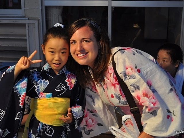 A Japanese girl and a white woman in yukata smile for the camera