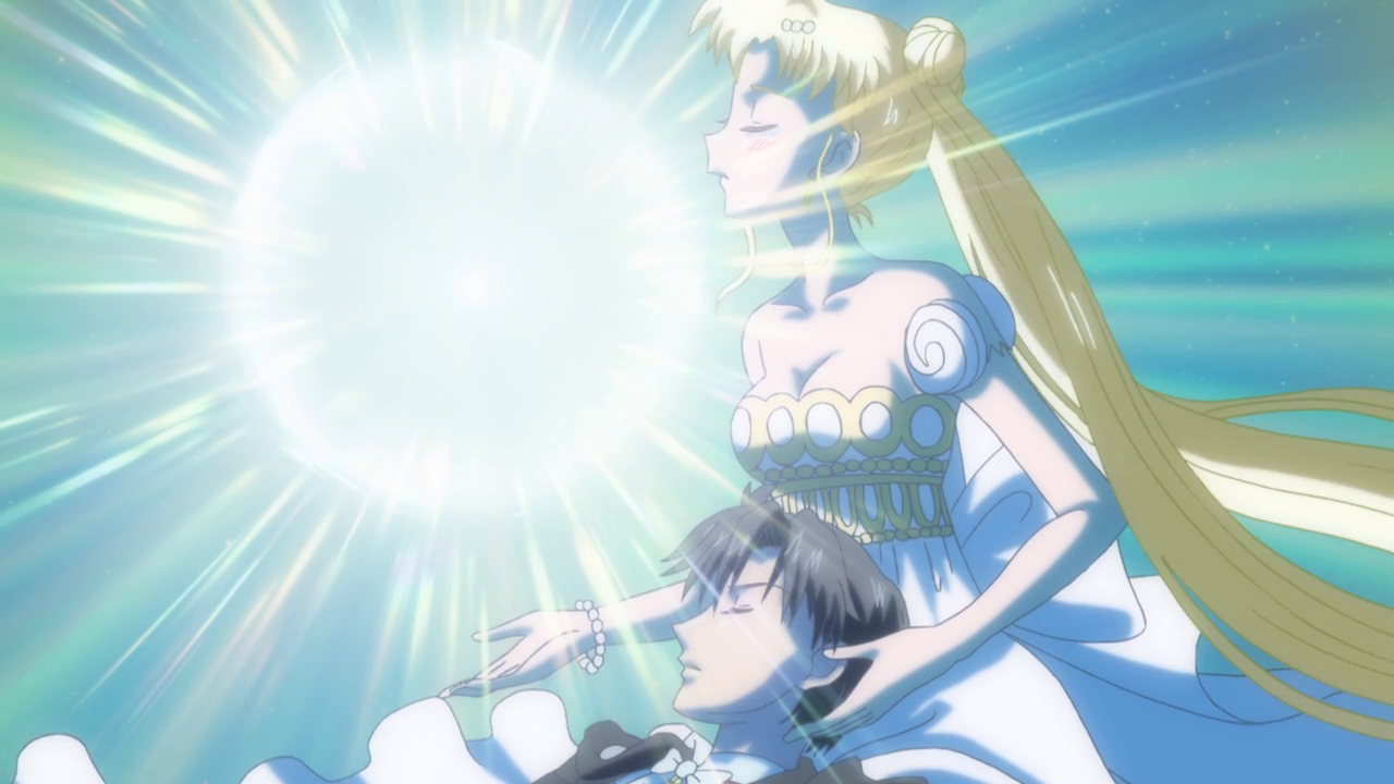Tuxedo Mask lays in Princess Serenity's lap as the Silver Crystal shines