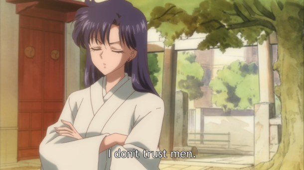 "Rei stands at the entrance of the shrine with the words ""I don't trust men."""