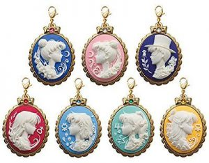 several cameo charms with a sailor guardian on each