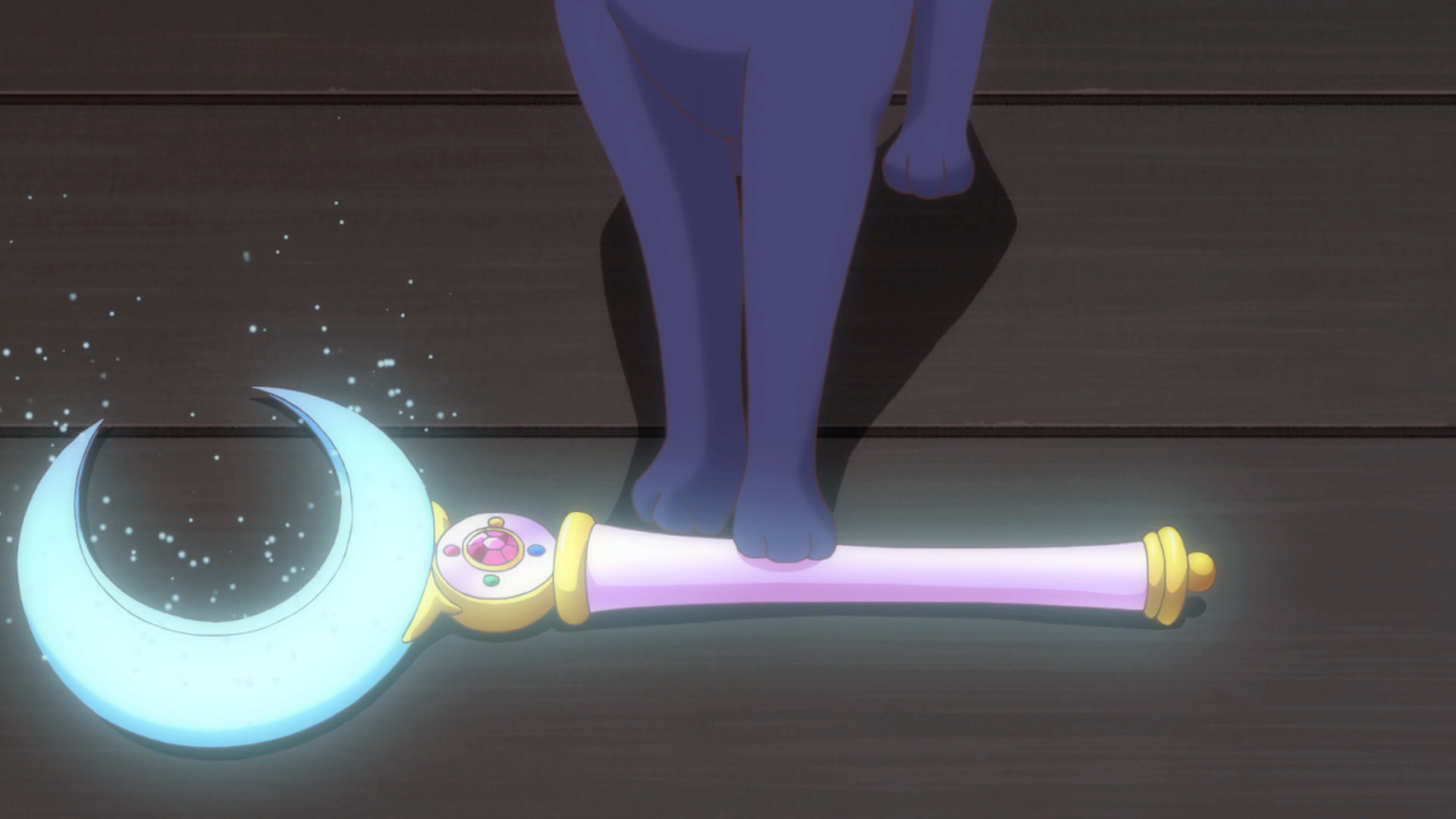 screenshot from sailor moon crystal where Luna presents the moon stick with a glowing moon stick with crystal crescent moon