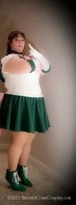 A fat white woman stands stoically in a Sailor Jupiter costume