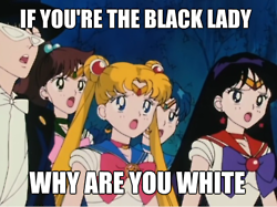 "Sailor Moon and the guardians stand dismayed with the words ""If you're the black lady then why are you white"" written across it"