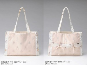 a cream colored hand bag with small sailor moon images
