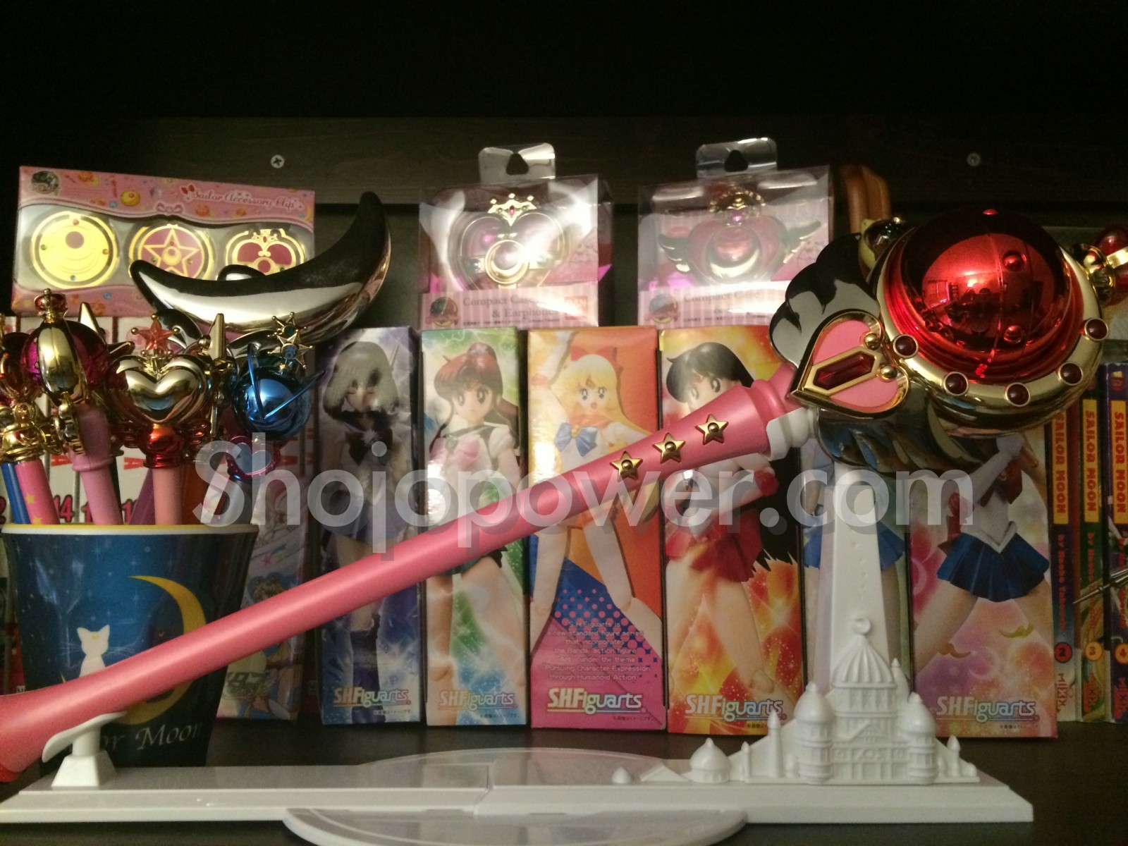 A Sailor Moon merchandise collection with the Cutie Moon rod, pointers and Figuarts