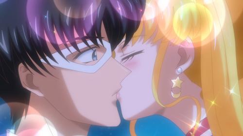 Sailor Moon kisses a surprised Tuxedo Mask