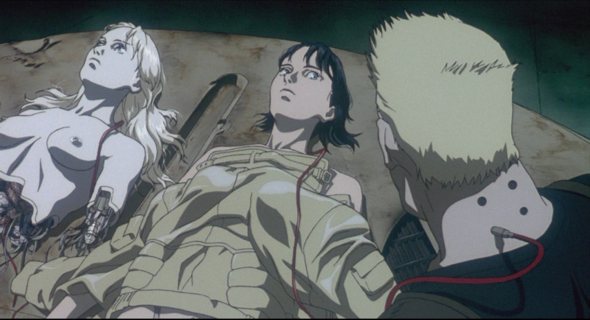 The puppet master and motoko lay side by side with Batou looks at them