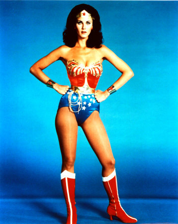 A woman with knee high red boots and wearing a star spangled outfit which looks like a bathing suit.